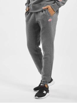 New Balance Spodnie do joggingu MP93512 szary