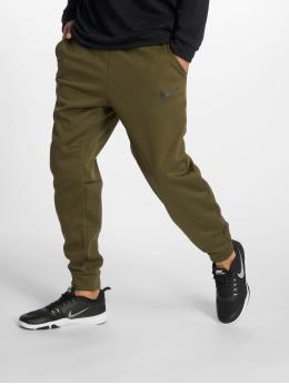 Nike Спортивные брюки Thrma Taper оливковый