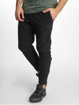 Nike Спортивные брюки Sportswear черный