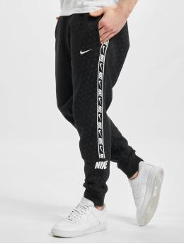 Nike Спортивные брюки M Nsw Repeat Flc Jogger Prnt черный