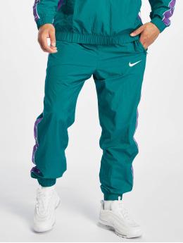 Nike Joggingbukser Swoosh Woven turkis