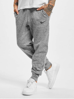 Nike Joggingbyxor Therma grå