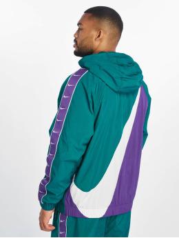 Nike Kurtki przejściowe Swoosh Woven turkusowy