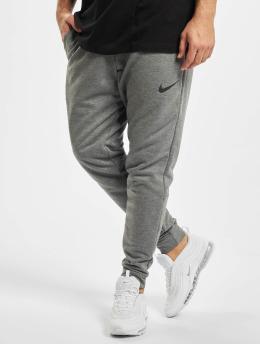 Nike Performance Spodnie do joggingu Dry Taper Fleece szary