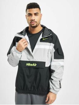 Nike Prechodné vetrovky Air Woven šedá