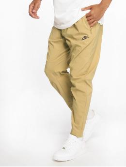 Nike Spodnie do joggingu Woven bezowy