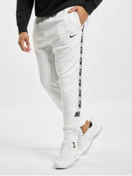 Nike Spodnie do joggingu M Nsw Repeat Flc bialy