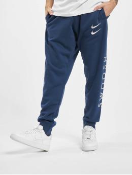 Nike Spodnie do joggingu Swoosh niebieski