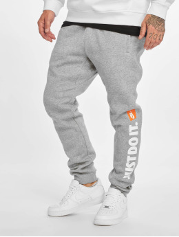 Nike Spodnie do joggingu Sportswear JDI Fleece szary
