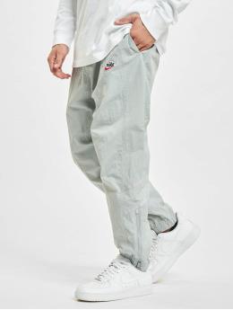 Nike Spodnie do joggingu M Nsw He WrLnd Wvn szary