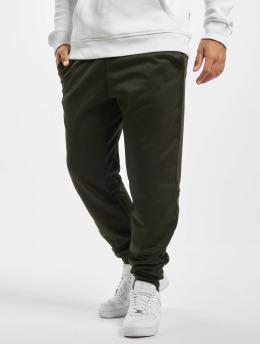 Nike Spodnie do joggingu Therma Taper zielony