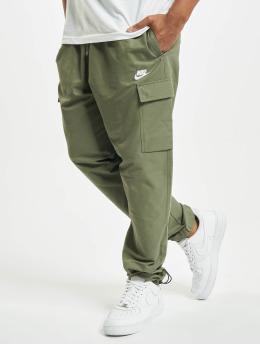 Nike Spodnie do joggingu Woven Players  zielony