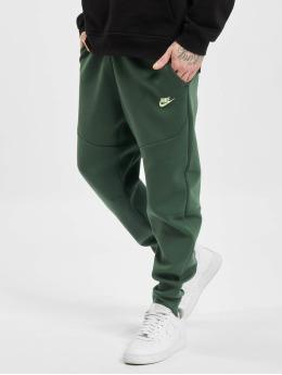 Nike Spodnie do joggingu M Nsw Tch Flc Jggr zielony