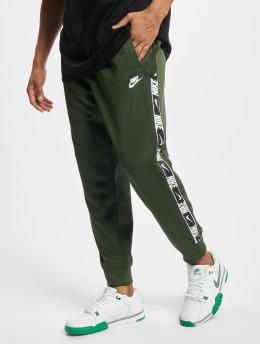Nike Spodnie do joggingu Repeat  zielony