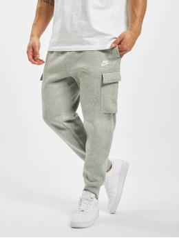 Nike tepláky Club Cargo šedá