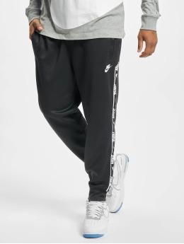 Nike tepláky Repeat  šedá