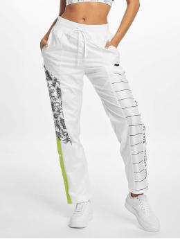 Nike tepláky TRK Woven biela