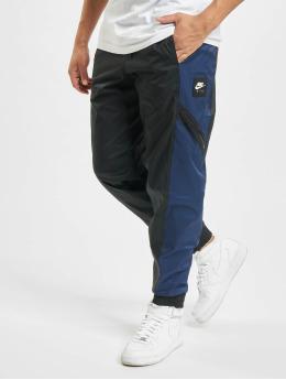 Nike tepláky M Nsw Air Lnd Wvn modrá