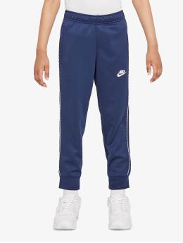 Nike tepláky Repeat  modrá