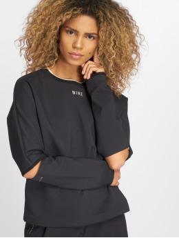 Nike / Tröja Sportswear Tech Pack i svart