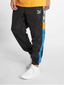 Puma Männer Jogginghose Puma XTG Woven in schwarz