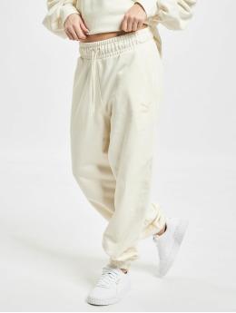 Puma Spodnie do joggingu Classics Relaxed Jogger bezowy