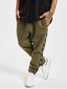 Reebok Спортивные брюки TE Tape зеленый
