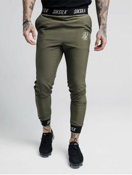 Sik Silk Jogging kalhoty Pursuit hnědožlutý