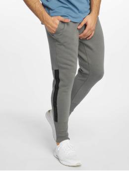 Under Armour Pantalons de jogging Accelerate Offpitch gris