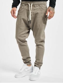 VSCT Clubwear Látkové kalhoty Spencer hnědožlutý