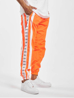 VSCT Clubwear Spodnie do joggingu MC Nylon Striped  pomaranczowy