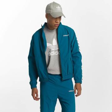 adidas Демисезонная куртка TNT Wind Top бирюзовый