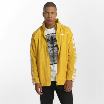 adidas Демисезонная куртка Superstar Windbreaker желтый