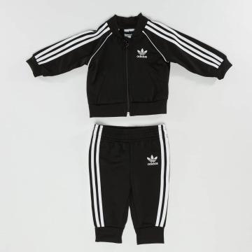 adidas Спортивные костюмы SST черный