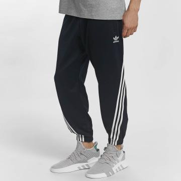 adidas originals Spodnie do joggingu Wrap niebieski