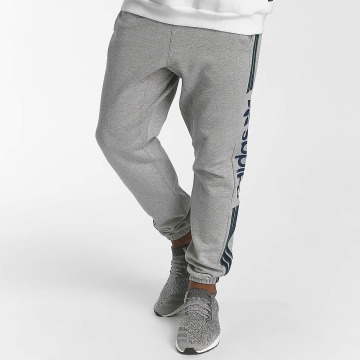 adidas originals tepláky Quarz Of Fleece šedá