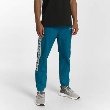 adidas originals Verryttelyhousut TNT Wind turkoosi
