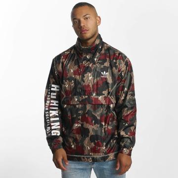 adidas Veste mi-saison légère Pharrell Williams HU Hiking camouflage