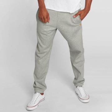 Carhartt WIP tepláky Chase Cotton/Polyester Heavy Sweat šedá