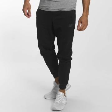 New Balance Spodnie do joggingu MP73543 Athletics czarny