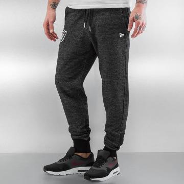 New Era Spodnie do joggingu Remix II Oakland Raiders czarny