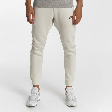 Nike joggingbroek NSW FLC CLUB beige