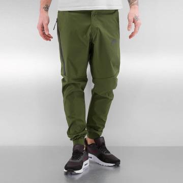 Nike Pantalon chino Sportswear Bonded vert