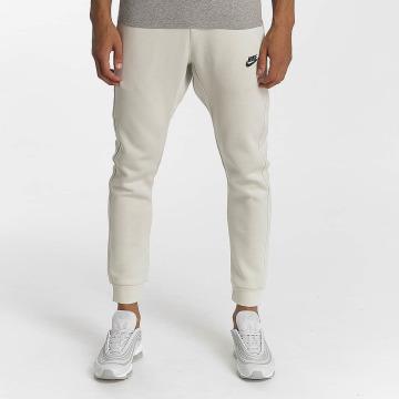 Nike Spodnie do joggingu NSW FLC CLUB bezowy