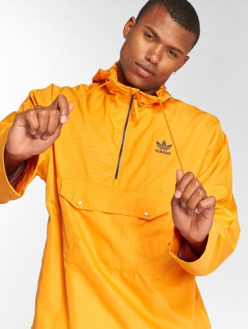 adidas originals Демисезонная куртка Half Zip оранжевый