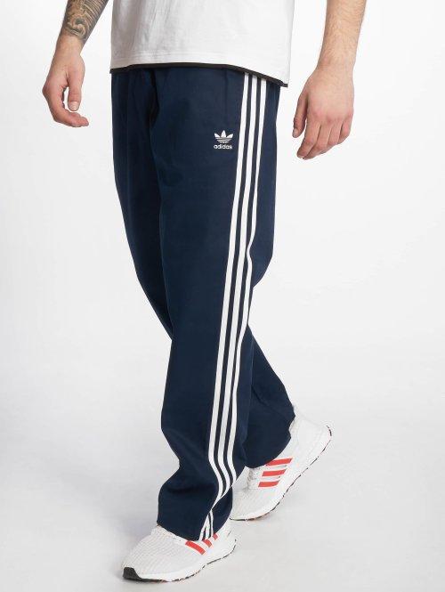 adidas originals Joggingbyxor Co Wvn Tp blå