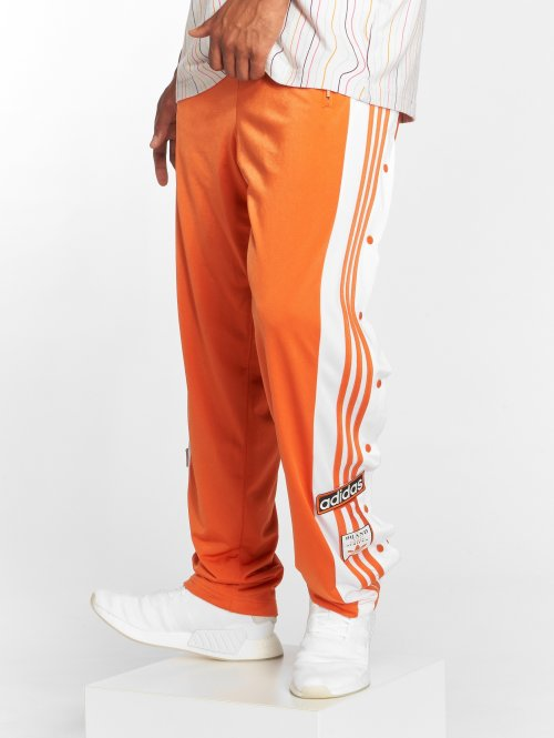 adidas originals Spodnie do joggingu Og Adibreak Tp pomaranczowy