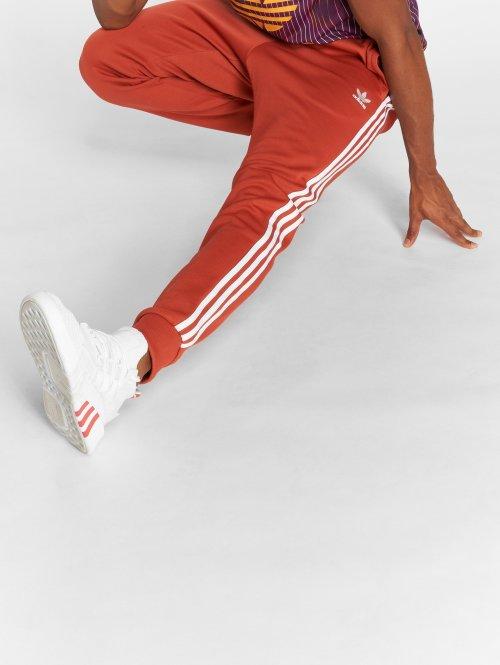 adidas originals tepláky Sst Tp oranžová