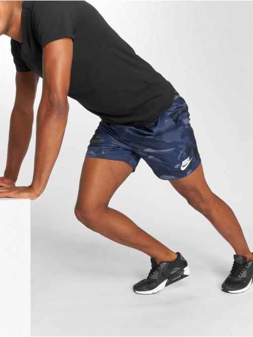 Nike Pantalón cortos Sportswear Flow Camo Woven azul