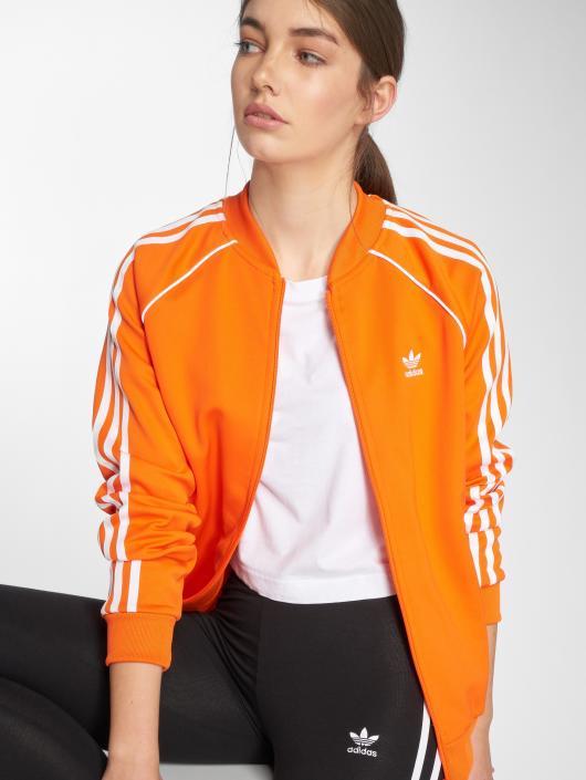 232a6f8f617 ... adidas originals Veste mi-saison légère Sst Tt Transition orange ...